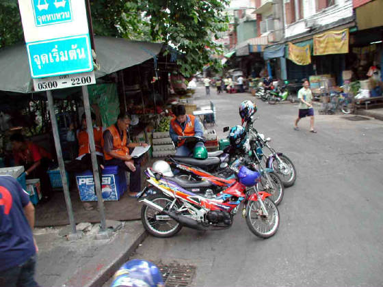 web-030704-motorcycle-taxis.jpg